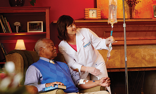BrightStar Care registered nurse performing infusion therapy for a client who has arthritis.