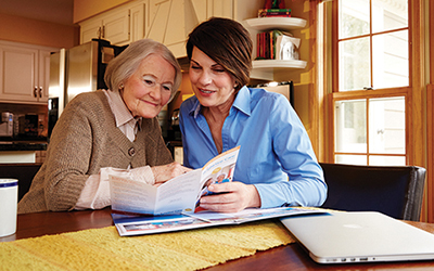 Daughter discusses home care options with her senior parent