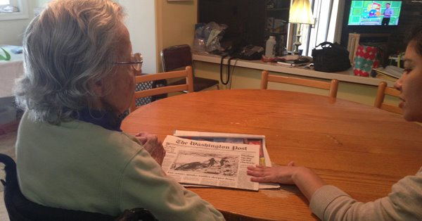 Jean and Veronica reading the daily newspaper