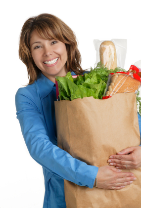 Woman holding bag of groceries for Holiday Healthy Eating