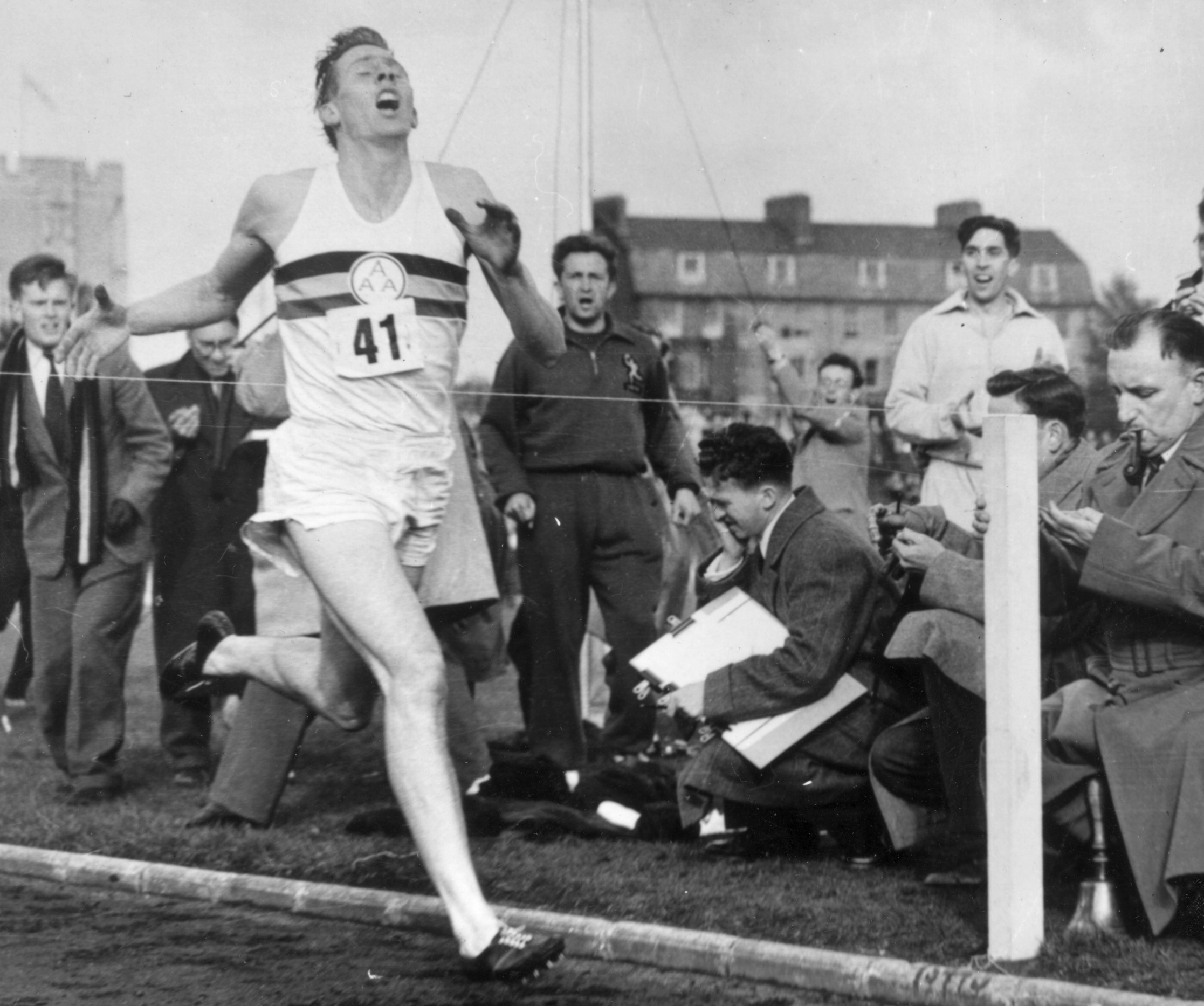 Roger Bannister about to cross the tape at the end of his record breaking mile run at Iffley Road, Oxford. He was the first person to run the mile in under four minutes, with a time of 3 minutes 59.4 seconds. (Photo by Norman Potter/Central Press/Getty Images)